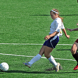 Photos by Tom Kelly IV<br /> WCU's Lexi Brown (27) shoots and scores on a break away as she is chased by IUP's Casey Reber (33) during the Indiana University of Pennsylvania (IUP) vs West Chester University (WCU) women's soccer game in East Bradford Township, Wednesday afternoon October 2, 2013.