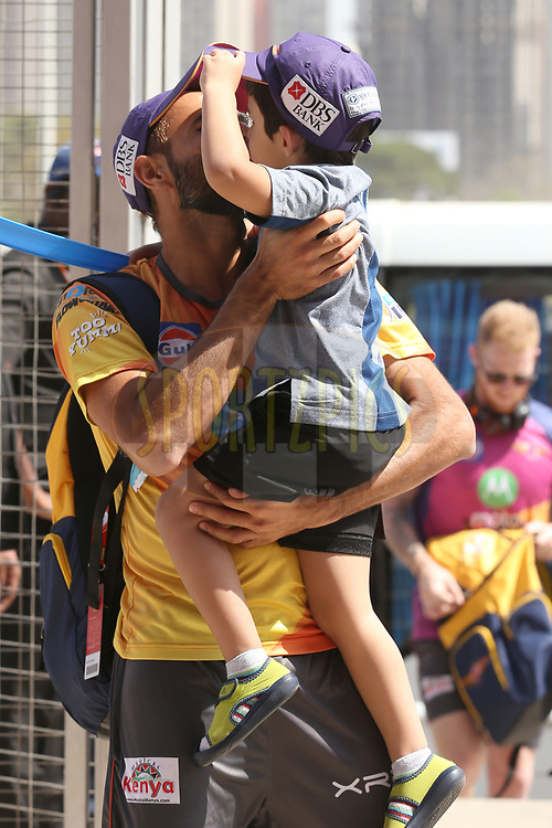 Imran Tahir of Rising Pune Supergiant kiss his son Gibran Tahir as they arrive during match 34 of the Vivo 2017 Indian Premier League between the Rising Pune Supergiants and the Royal Challengers Bangalore   held at the MCA Pune International Cricket Stadium in Pune, India on the 29th April 2017<br /> <br /> Photo by Faheem Hussain - Sportzpics - IPL