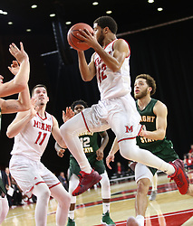 November 14, 2017 - Oxford, Ohio, U.S - Miami (Oh) Redhawks guard Darrian Ringo (12) head in as he set up to pass the ball off. During play in Oxford,Ohio. As the Redhawks  take down the Wright State Raiders in Oxford,Ohio 73 to 67 on Tue Nov 14, 2017 on Miami Ohio campus. (Credit Image: © Ernest Coleman via ZUMA Wire)