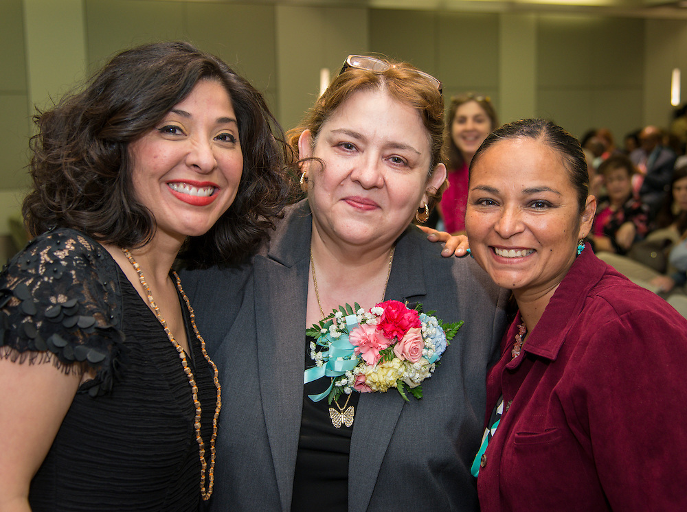 Juliet Stipeche, SanJuana Elizando and Maria Elena Galan pose for a photograph during the Houston ISD Board of Trustees meeting, May 14, 2015.