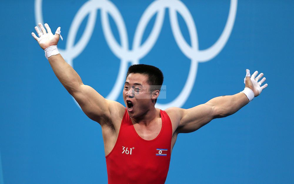 Un Guk Kim of the Democratic People's Republic of Korea celebrates after lifting 153kg for an Olympic record during the mens 62kg weightlifting event during day 3 of the London Olympic Games London, 30 Jul 2012..(Jed Jacobsohn/for The New York Times)....