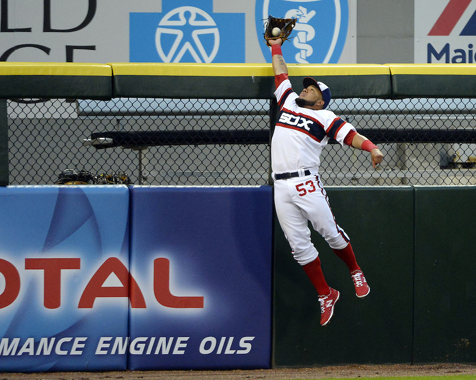 White Sox outfielder Melky Cabrera leaps for a fly ball during an MLB game at U.S. Cellular Field on May 5, 2015.  (Photo by Ron Vesely).