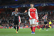 Arsenal attacker Mesut Ozil (11) looking at floor during the Champions League round of 16, game 2 match between Arsenal and Bayern Munich at the Emirates Stadium, London, England on 7 March 2017. Photo by Matthew Redman.