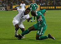 Photo: Steve Bond/Richard Lane Photography.<br />Ghana v Nigeria. Africa Cup of Nations. 03/02/2008. Asamoah Gyan (L) cannot get around Daniel Shittu (R)