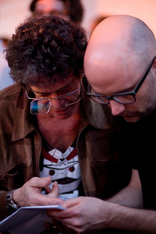 Lou Reed and Moby look over the lyrics to 'Walk on the Wild Side' before performing together at the Levi/FADER Fort during the 2008 SXSW music festival in Austin, TX.