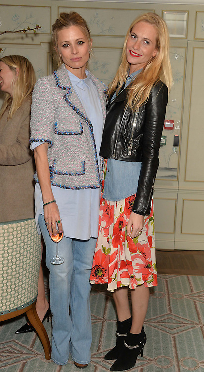 Left to right, LAURA BAILEY and POPPY DELEVINGNE at the launch of Mrs Alice in Her Palace - a fashion retail website, held at Fortnum & Mason, Piccadilly, London on 27th March 2014.