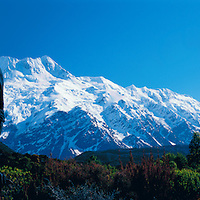 Sir Edmund Hillary looking up to Mount Cook in the Southern Alps of New Zealand