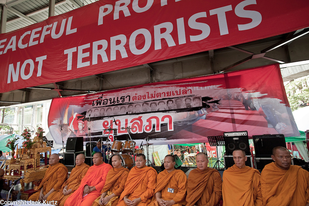 "10 MAY 2010 - BANGKOK, THAILAND: Buddhist monks lead a special memorial service for people killed in political street violence in Bangkok on April 10. The Red Shirts held a special memorial service at their main protest site in Ratchaprasong Intersection Monday with Buddhist monks leading chants to mark the one month anniversary of the street violence on April 10 that left 25 dead and more than 800 injured. Thai media is reporting that Prime Minister Abhisit Vejjajiva has given the Red Shirts has given the Red Shirts until the end of today to either accept his ""Road Map for Reconciliation"" and end the protest or face unspecified consequences widely thought to include a military crackdown.   Photo by Jack Kurtz / ZUMA Press"