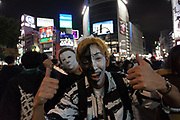 A Japanese man in costume gives a double thumbs-up in front of the iconic Shibuya crossing during the Halloween celebrations Shibuya, Tokyo, Japan. Saturday October 27th 2018. The celebrations marking this event have grown in popularity in Japan recently. Enjoyed mostly by young adults who like to dress up, drink , dance and misbehave in parts of Tokyo like Shibuya and Roppongi. There has been a push back from Japanese society and the police to try to limit the bad behaviour.