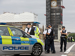 © Licensed to London News Pictures. 14/08/2018. London, UK. Police man the cordon on the south side of Westminster Bridge after a car crashed into security barriers in Parliament Square. Counterterrorism police are reportedly leading the investigation. Photo credit: Rob Pinney/LNP