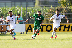 18.07.2014, Sportplatz Jettingen, Jettingen, GER, FS Vorbereitung, Karlsruher SC vs FC Augsburg, im Bild l-r: im Zweikampf, Aktion, mit Yamada #9 (Karlsruher SC), Sascha Moelders #33 (FC Augsburg) und Koen van der Biezen #28 (Karlsruher SC) // during a Friendly Match between Karlsruher SC and FC Augsburg at the Sportplatz Jettingen in Jettingen, Germany on 2014/07/18. EXPA Pictures © 2014, PhotoCredit: EXPA/ Eibner-Pressefoto/ Kolbert<br /> <br /> *****ATTENTION - OUT of GER*****