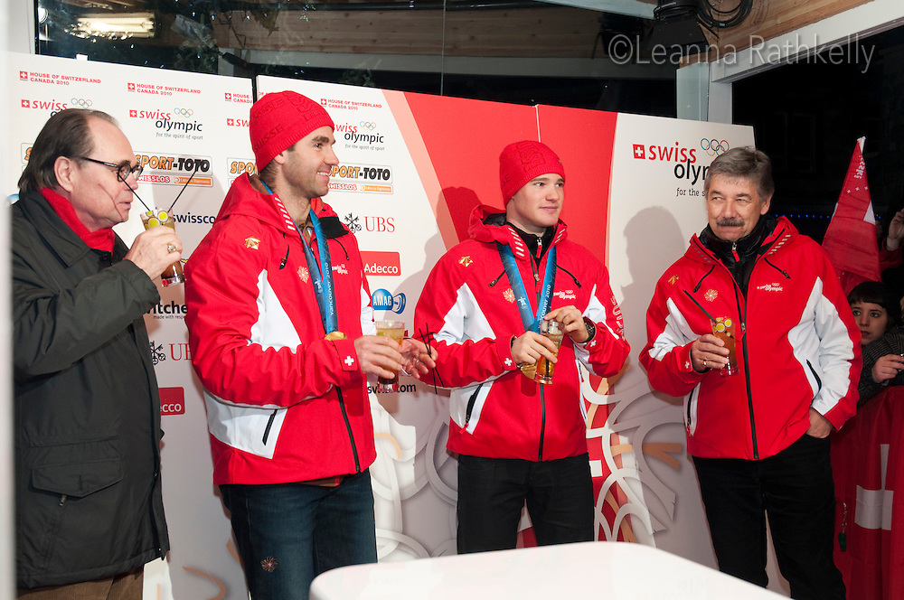 Gold Medal winners Dario Cologna and Didier Defago celebrate their wins at the House of Switzerland in Whistler during the 2010 Olympic Winter games in Whistler, BC Canada.