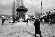 Sarajevo residents walk without fear of being shot by Serb snipers in the square of the old part of town called Bascarsija during the final days of the siege of the city, Sarajevo, Bosnia and Herzegovina, January 1996. PHOTO BY ROGER RICHARDS