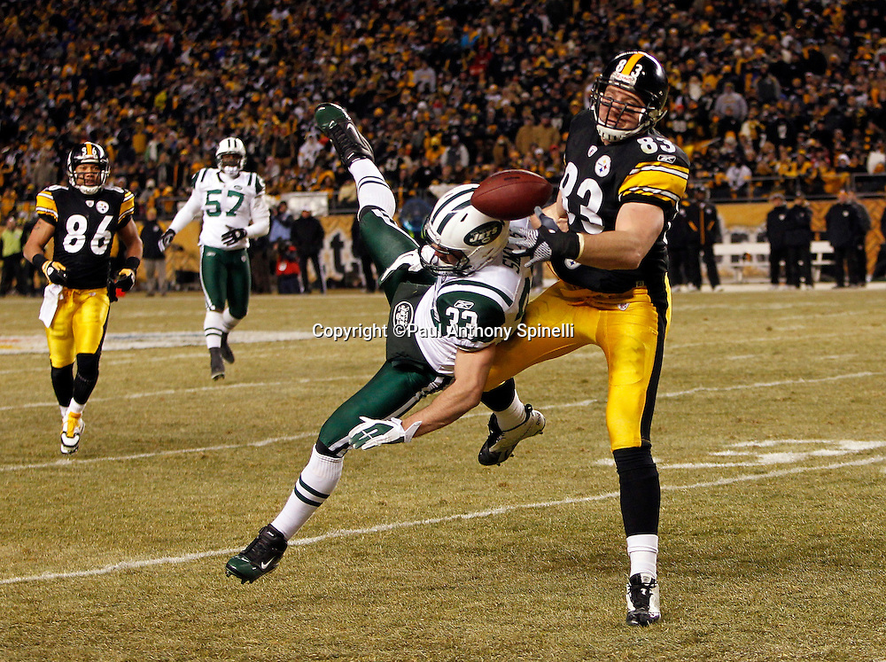 New York Jets safety Eric Smith (33) breaks up a second quarter pass intended for Pittsburgh Steelers tight end Heath Miller (83) during the NFL 2011 AFC Championship playoff football game against the Pittsburgh Steelers on Sunday, January 23, 2011 in Pittsburgh, Pennsylvania. The Steelers won the game 24-19. (©Paul Anthony Spinelli)