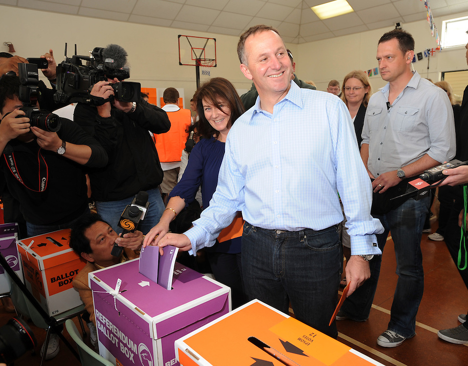 Prime Minister John Key, right and his wife Bronagh cast their vote in the General Election at Parnell Primary School, Auckland, New Zealand, Saturday, November 26, 2011. Credit:SNPA / Ross Setford