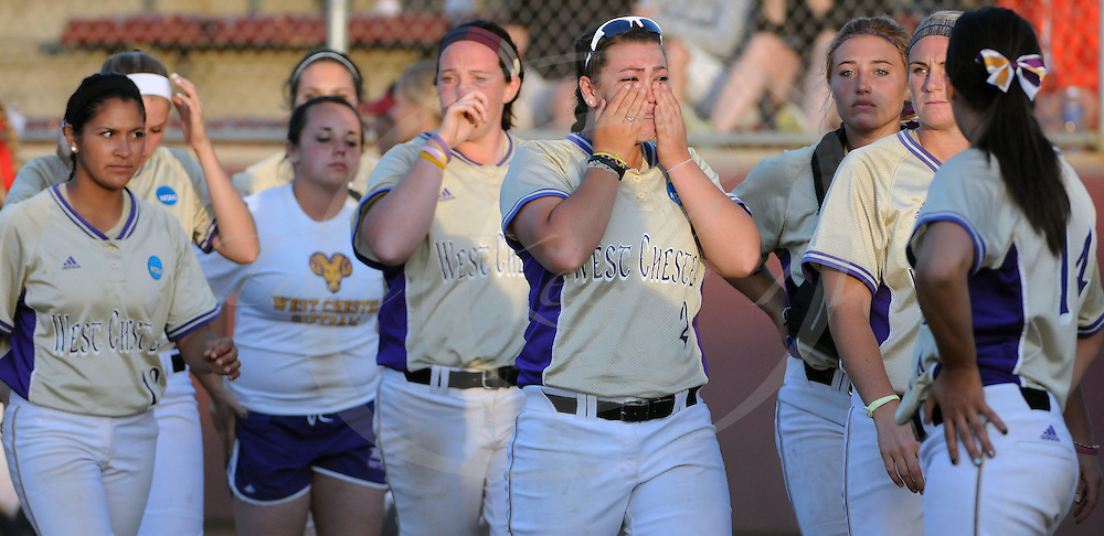 Staff photos by Tom Kelly IV<br /> West Chester players show their emotions, after being defeated by Dixie State.  West Chester University was defeated by Dixie State in their third game of the 2014 NCAA Division II Softball Championship which is being held at Moyer Sports Complex, in Salem, Virginia.  The final score on Saturday May 24, 2014 was 4 - 3, and West Chester was eliminated from the tournament with this being their second loss.