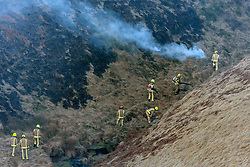 © Licensed to London News Pictures. 27/02/2019. Marsden UK. Fire crews remain on the scene of a large fire on Saddleworth moor this morning near the town of Marsden in Yorkshire. Photo credit: Andrew McCaren/LNP