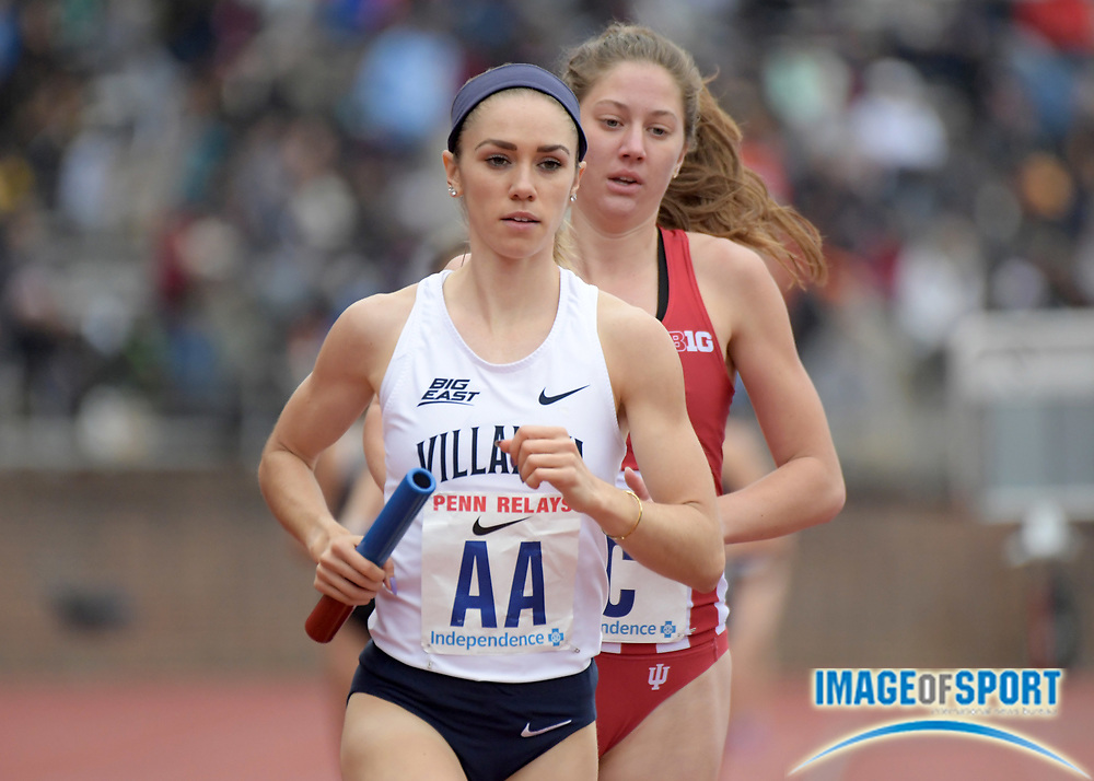 Apr 27, 2018; Philadelphia, PA, USA; Kaley Ciluffo runs the second leg on the Villanova women's 4 x 1,500m relay that won the Championship of America race in 17:35.48 during the 124th Penn Relays at Franklin Field.