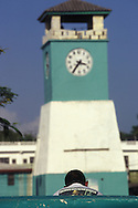 BELIZE / Punta Gorda / Young man with a shirt of Schwarzenegger sitting next to the Clock Tower...© JOAN COSTA