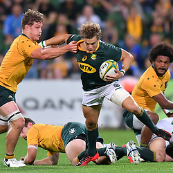 Andries Coetzee of South Africa hands off Michael Hooper of Australia