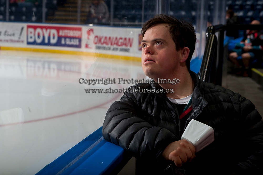 KELOWNA, CANADA - JANUARY 5: A young fan stands at the  boards and watches the jumbotron prior to the players entering the ice as the Kelowna Rockets take on the Seattle Thunderbirds on January 5, 2017 at Prospera Place in Kelowna, British Columbia, Canada.  (Photo by Marissa Baecker/Shoot the Breeze)  *** Local Caption ***