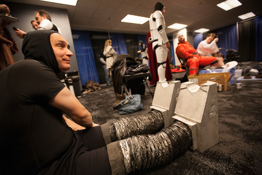 Phil Glover of Minneapolis puts on his Gonk legs and feet as the 501st Legion Central Garrison attends Star Wars night at the Timberwolves game at Target Center in Minneapolis December 15, 2015.