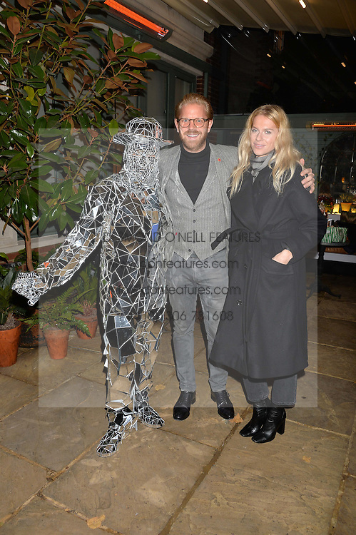 The Ivy Chelsea Garden's Guy Fawkes Party & Launch of The Winter Garden was held on 5th November 2016.<br /> Picture shows:- Performer with ALISTAIR GUY and BARBORA BEDIOVA.
