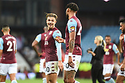 Aston Villa midfielder Jack Grealish (10) smiles as he chats to Aston Villa defender Tyrone Mings (40) during the Premier League match between Aston Villa and Everton at Villa Park, Birmingham, England on 23 August 2019.