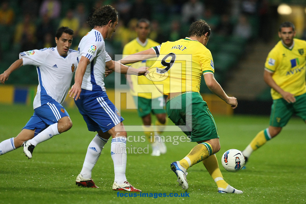 Grant Holt of Norwich and Maurizio Lanzaro of Real Zaragoza during a pre season friendly at Carrow Road stadium, Norwich...Picture by Paul Chesterton/Focus Images Ltd.  07904 640267.3/8/11