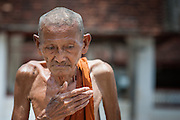 Skinny old Buddhist monk in Luang Prabang (Laos)