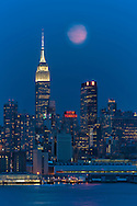 USA, New York, Manhattan, Midtown Skyline seen from New Jersey, moonrise and Empire State BuildingMoon over Manhattan