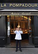 Dominique Anract, baker, holding baguettes outside his bakery La Pompadour, on the Rue de la Tour in the 16th arrondissement of Paris, France. Dominique Anract comes from a family of bakers and this is his third bakery, where he employs 30 people and 8 apprentices, housed in a building built in 1868 under Napoleon III. He is also president of the Confederation Nationale de la Boulangerie-Patisserie Francaise, or National Confederation of French Bakery, tasked to protect the quality and integrity of French bakery and patisserie. Photographed on 16th January 2019 by Manuel Cohen