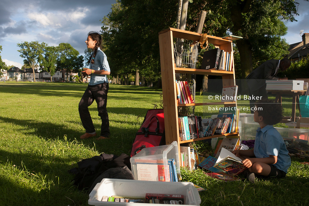 Members of the campaign to save nearby Carnegie Library in Herne Hill and closed by Lambeth council, organise a pop-up library and party in Ruskin Park, SE24 on 21st June 2016, in south London, United Kingdom. Shut since 31st March, children, the elderly and other adult groups have been prevented from using the building uphill from this location as Lambeth decide how to use the public space, bequeathed to the community by philanthropist, Andrew carnegie in 1911. (Photo by Richard Baker / In Pictures via Getty Images)
