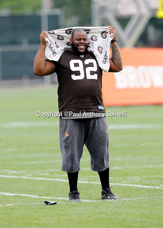 Cleveland Browns defensive lineman Shaun Rogers (92) smiles as he walks on the sidelines during NFL football training camp at the Cleveland Browns Training Complex on Monday, August 9, 2010 in Berea, Ohio. (©Paul Anthony Spinelli)