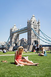 © Licensed to London News Pictures. 26/05/2017. LONDON, UK.  Office workers and tourists enjoy the sunshine on the south bank near Tower Bridge at lunchtime. The capital has experienced another day of hot and sunny weather. Photo credit: Vickie Flores/LNP