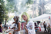 "ROME, ITALY - 3 JULY 2016: (R-L) Gipsy Queen member Codruta Balteau (24) and Aninfa Hokic (31) prepare typical Roma dishes at their food stand at the iFest, an alternative music festival  in Rome, Italy, on July 3rd 2016.<br /> <br /> The Gipsy Queens are a travelling catering business founded by Roma women in Rome.<br /> <br /> In 2015 Arci Solidarietà, an independent association for the promotion of social development, launched the ""Tavolo delle donne rom"" (Round table of Roma women) to both incentivise the process of integration of Roma in the city of Rome and to strengthen the Roma women's self-esteem in the context of a culture tied to patriarchal models. The ""Gipsy Queens"" project was founded by ten Roma women in July 2015 after an event organised together with Arci Solidarietà in the Candoni Roma camp in the Magliana, a neighbourhood in the South-West periphery of Rome, during which people were invited to dance and eat Roma cuisine. The goal of the Gipsy Queen travelling catering business is to support equal opportunities and female entrepreneurship among Roma women, who are often relegated to the roles of wives and mothers."