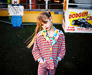 Circus performer, 8 year old Wonona outside the Dodgem Cars at Webber's Circus in Sydney, 2009.