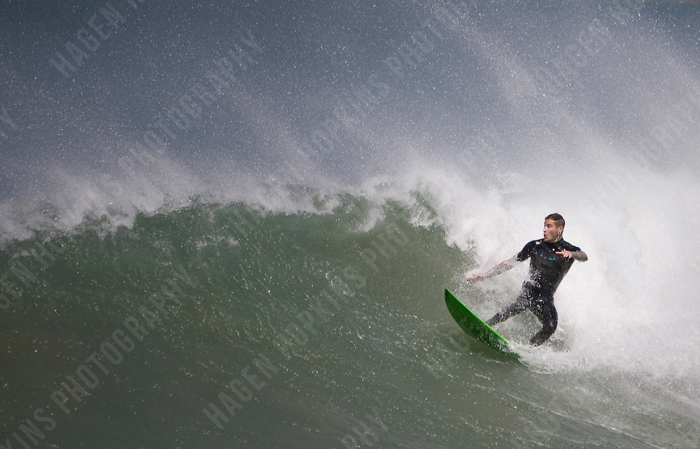 SURFING AT LYALL BAY, WELLINGTON