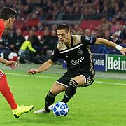 NLD/Amsterdam/20181023 - Champions Leaguewedstrijd  Ajax - SL Benfica, nr.10 Dusan Tadic en nr.34 Andre Almeida