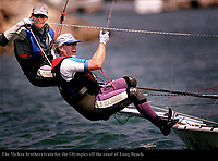 8/24/00 -Helmsman Jonathan McKee,40, (top) takes the line in his teeth whil his brother Charlie McKee,38, both of Seattle, Washington , crews while training for the Olympics in their 49er  class sailboat off the coast of Long Beach on Thursday, August 24, 2000. The brother team will represent the U.S. in the new 49er class sailing races in Sydney next month. <br />