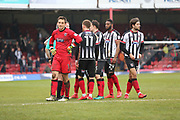 Grimsby Town players whilst the the match was stopped because of crows trouble during the EFL Sky Bet League 2 match between Grimsby Town FC and Port Vale at Blundell Park, Grimsby, United Kingdom on 10 March 2018. Picture by Mick Atkins.