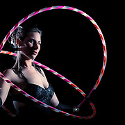 """Zeut both practices and teaches a style of dance called """"hoop dancing"""" that combines movement with hula hoops."""