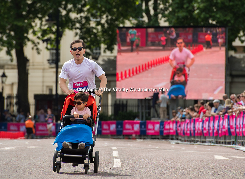 Runners complete their mile in the family waves at The Vitality Westminster Mile, Sunday 28th May 2017.<br /> <br /> Photo: Thomas Lovelock for The Vitality Westminster Mile<br /> <br /> For further information: media@londonmarathonevents.co.uk