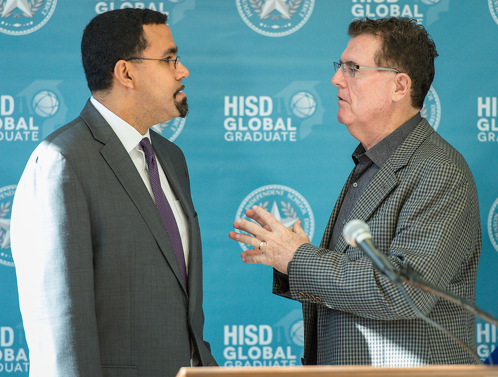 Acting US Secretary of Education John King, left, talks with Houston ISD Superintendent Dr. Terry Grier, right, during a visit to Sharpstown High School, January 15, 2016.