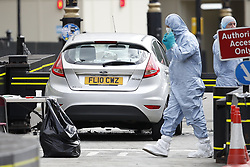 © Licensed to London News Pictures. 14/08/2018. London, UK. Police forensics officers gather evidence from a car that crashed into security barriers outside Parliament. A man had been arrested. A number of people are injured. Photo credit: Peter Macdiarmid/LNP