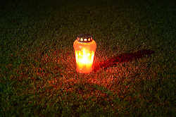 A candle in the middle of the football field Fazanerija, the stadium of ND Mura 05 - protest against a board of the club Mura 05; a day before match between Mura 05 and Maribor 21th Round of Slovenian First League PrvaLiga NZS 2012/13 on December 2, 2012 in Murska Sobota, Slovenia. (Photo By Ales Cipot / Sportida)