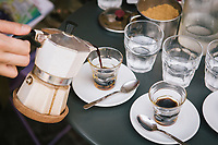 """NAPLES, ITALY - 13 JULY 2017: Espresso coffee is served here at """"In Tabula"""", a cafe and lunch restaurant in Piazza Bellini in Naples, Italy, on July 13th 2017."""