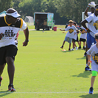 Juan Long races Rylan Estes, 5, Saturday during the All-Star Football Camp benefiting the Boys and Girls Clubs of North Mississippi at Ballard Park