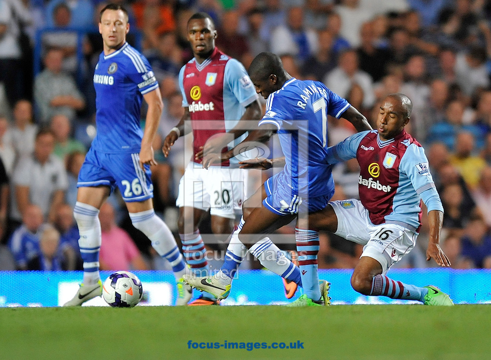 Picture by Alan Stanford/Focus Images Ltd +44 7915 056117<br /> 21/08/2013<br /> Ramires of Chelsea and is tackled by Fabian Delph of Aston Villa during the Barclays Premier League match at Stamford Bridge, London.