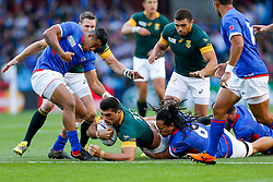South Africa Inside Centre Damian De Allende is tackled by Samoa Flanker TJ Ioane - Mandatory byline: Rogan Thomson/JMP - 07966 386802 - 26/09/2015 - RUGBY UNION - Villa Park - Birmingham, England - South Africa v Samoa - Rugby World Cup 2015 Pool B.